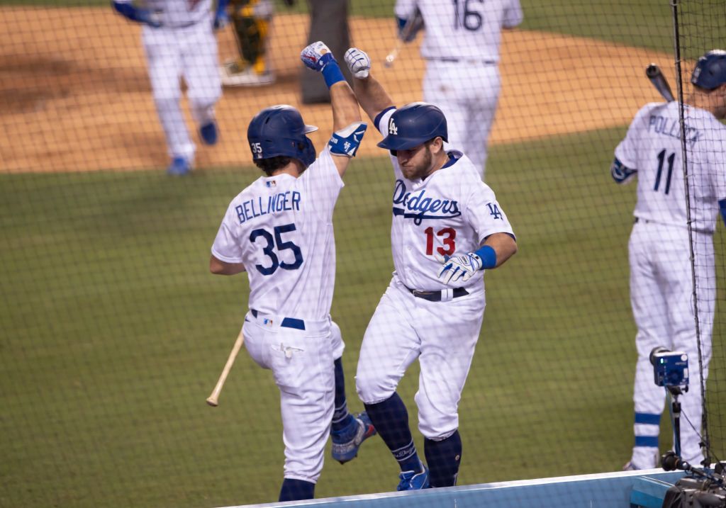 LOS ANGELES, CA - SEPTEMBER 23: Los Angeles Dodgers second baseman Max Muncy (13) celebrates with Los Angeles Dodgers center fielder Cody Bellinger (35) after his RBI home run during the game between the Oakland Athletics and the Los Angeles Dodgers on September 23, 2020, at Dodger Stadium in Los Angeles, CA
