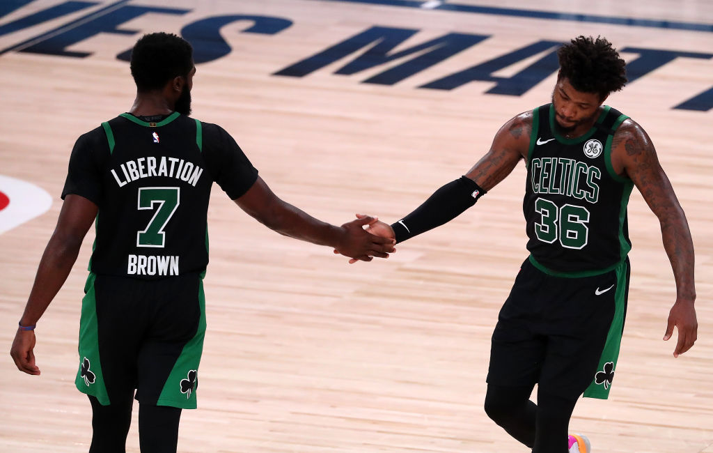 LAKE BUENA VISTA, FLORIDA - SEPTEMBER 11: Jaylen Brown #7 of the Boston Celtics and Marcus Smart #36 of the Boston Celtics react during the fourth quarter against the Toronto Raptors in Game Seven of the Eastern Conference Second Round during the 2020 NBA Playoffs at AdventHealth Arena at the ESPN Wide World Of Sports Complex on September 11, 2020 in Lake Buena Vista, Florida