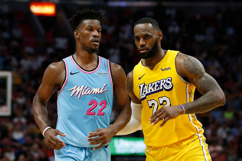 MIAMI, FLORIDA - DECEMBER 13: LeBron James #23 of the Los Angeles Lakers guards Jimmy Butler #22 of the Miami Heat during the second half at American Airlines Arena on December 13, 2019 in Miami, Florida