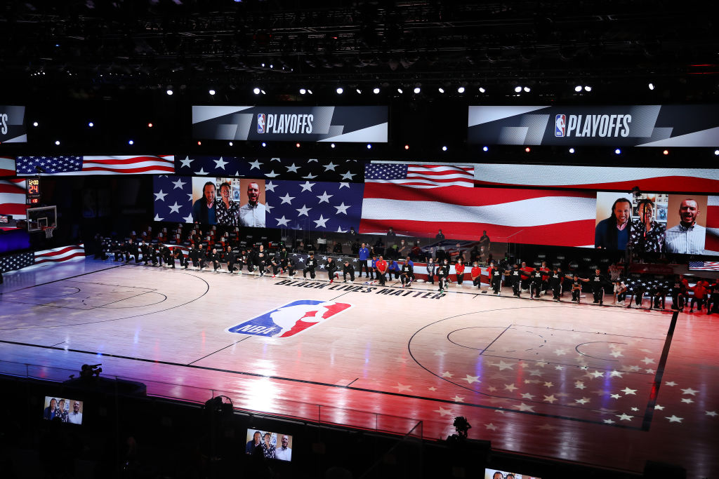 LAKE BUENA VISTA, FLORIDA - SEPTEMBER 13: The LA Clippers and the Denver Nuggets kneel during the National Anthem in Game Six of the Western Conference Second Round during the 2020 NBA Playoffs at AdventHealth Arena at the ESPN Wide World Of Sports Complex on September 12, 2020 in Lake Buena Vista, Florida