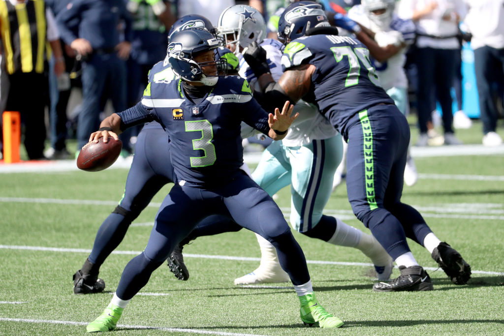SEATTLE, WASHINGTON - SEPTEMBER 27: Russell Wilson #3 of the Seattle Seahawks looks to throw a pass against the Dallas Cowboys during the first quarter in the game at CenturyLink Field on September 27, 2020 in Seattle, Washington