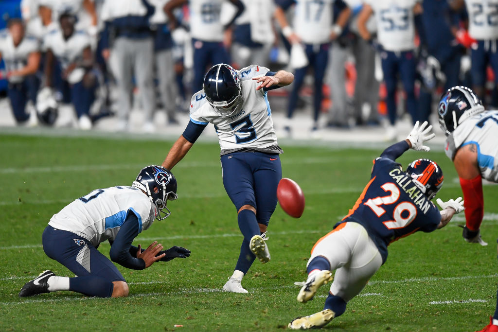 DENVER, CO - SEPTEMBER 14: Stephen Gostkowski #3 of the Tennessee Titans kicks a go-ahead fourth quarter field goal as Brett Kern #6 holds and Bryce Callahan #29 of the Denver Broncos covers the play during a game at Empower Field at Mile High on September 14, 2020 in Denver, Colorado