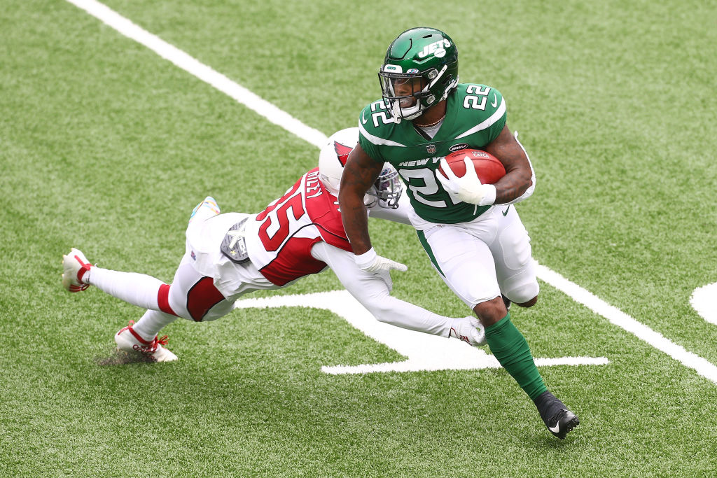 EAST RUTHERFORD, NEW JERSEY - OCTOBER 11: La'Mical Perine #22 of the New York Jets runs with the ball by Curtis Riley #35 of the Arizona Cardinals at MetLife Stadium on October 11, 2020 in East Rutherford, New Jersey. Arizona Cardinals defeated the New York Jets 30-10