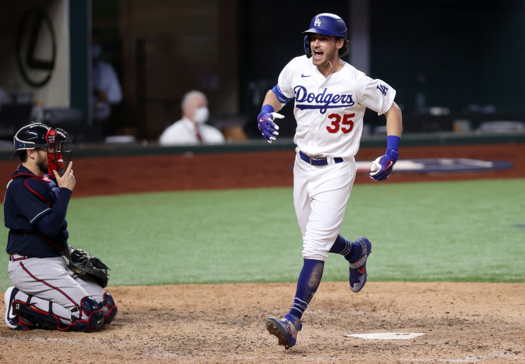ARLINGTON, TEXAS - OCTOBER 18: Cody Bellinger #35 of the Los Angeles Dodgers crosses home plate after hitting a solo home run against the Atlanta Braves during the seventh inning in Game Seven of the National League Championship Series at Globe Life Field on October 18, 2020 in Arlington, Texas