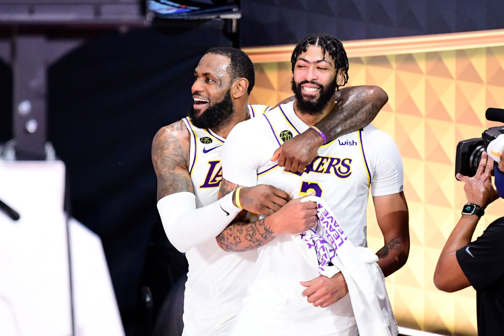 LAKE BUENA VISTA, FLORIDA - OCTOBER 11: LeBron James #23 of the Los Angeles Lakers and Anthony Davis #3 of the Los Angeles Lakers react after winning the 2020 NBA Championship in Game Six of the 2020 NBA Finals at AdventHealth Arena at the ESPN Wide World Of Sports Complex on October 11, 2020 in Lake Buena Vista, Florida