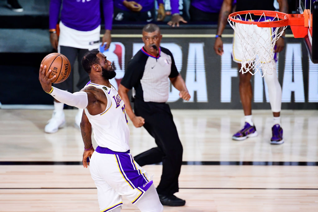 LAKE BUENA VISTA, FLORIDA - OCTOBER 11: LeBron James #23 of the Los Angeles Lakers dunks the ball during the first quarter against the Miami Heat in Game Six of the 2020 NBA Finals at AdventHealth Arena at the ESPN Wide World Of Sports Complex on October 11, 2020 in Lake Buena Vista, Florida