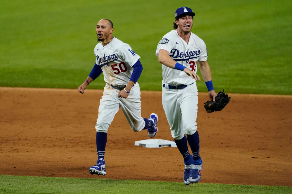 ARLINGTON, TX - OCTOBER 27: Mookie Betts #50 of the Los Angeles Dodgers celebrates with Cody Bellinger #35 after defeating the Tampa Bay Rays 3-1 in Game Six to win the 2020 MLB World Series at Globe Life Field on Tuesday, October 27, 2020 in Arlington, Texas
