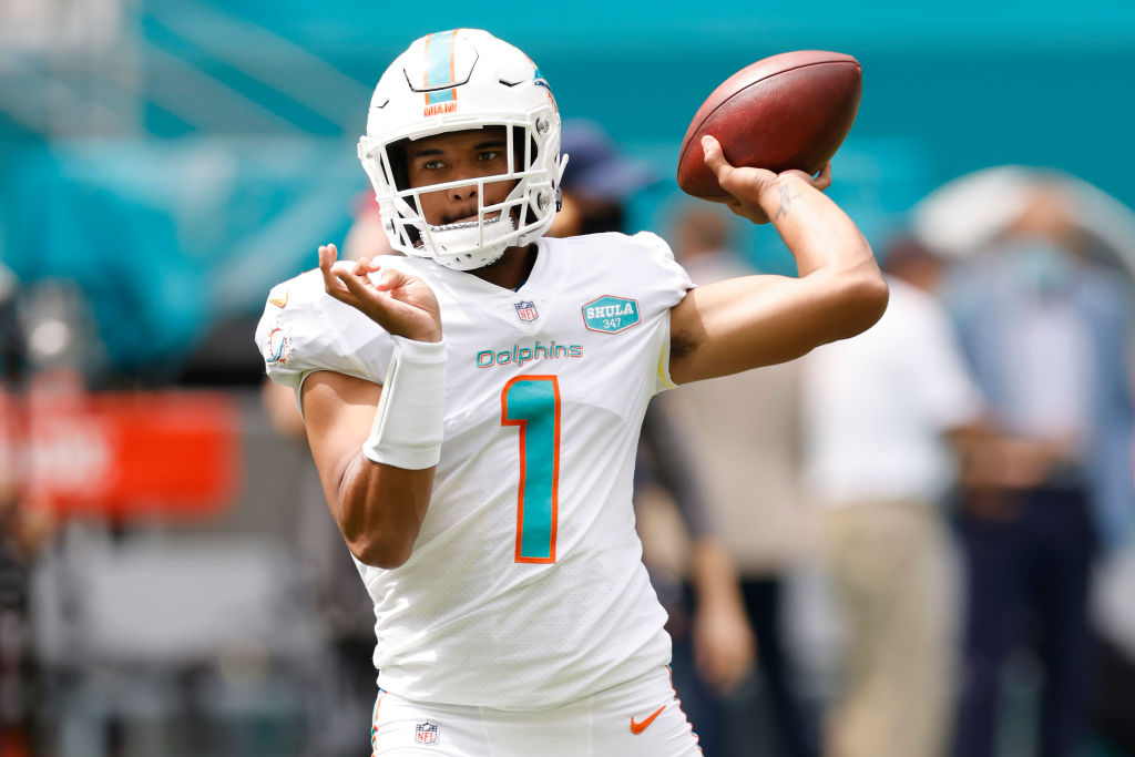 MIAMI GARDENS, FLORIDA - OCTOBER 04: Tua Tagovailoa #1 of the Miami Dolphins warms up prior to the game against the Seattle Seahawks at Hard Rock Stadium on October 04, 2020 in Miami Gardens, Florida