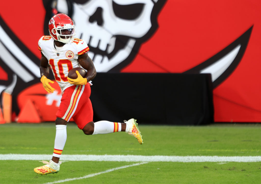 TAMPA, FLORIDA - NOVEMBER 29: Tyreek Hill #10 of the Kansas City Chiefs carries the ball in for a touchdown following a catch during their game against the Tampa Bay Buccaneers at Raymond James Stadium on November 29, 2020 in Tampa, Florida
