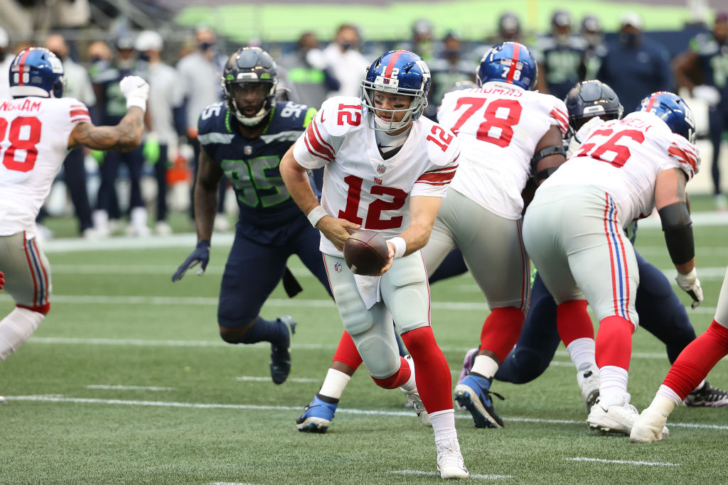 SEATTLE, WASHINGTON - DECEMBER 06: Colt McCoy #12 of the New York Giants looks to hand the ball off in the second quarter against the Seattle Seahawks at Lumen Field on December 06, 2020 in Seattle, Washington