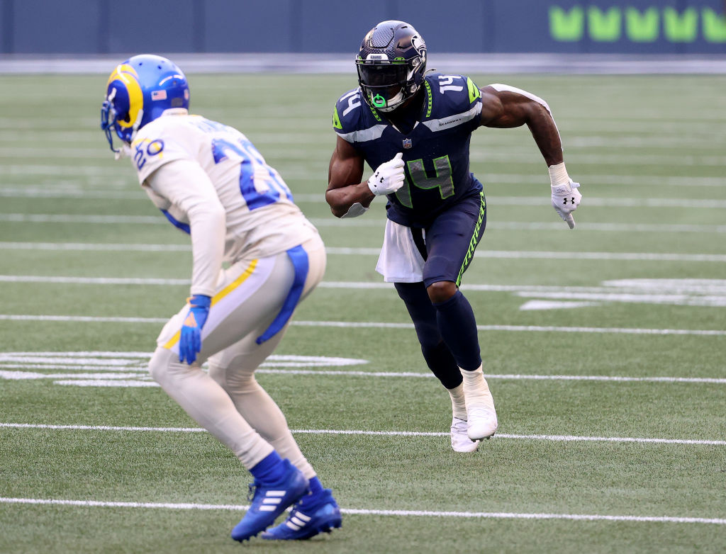 SEATTLE, WASHINGTON - DECEMBER 27: DK Metcalf #14 of the Seattle Seahawks and Jalen Ramsey #20 of the Los Angeles Rams in action during the second quarter at Lumen Field on December 27, 2020 in Seattle, Washington.
