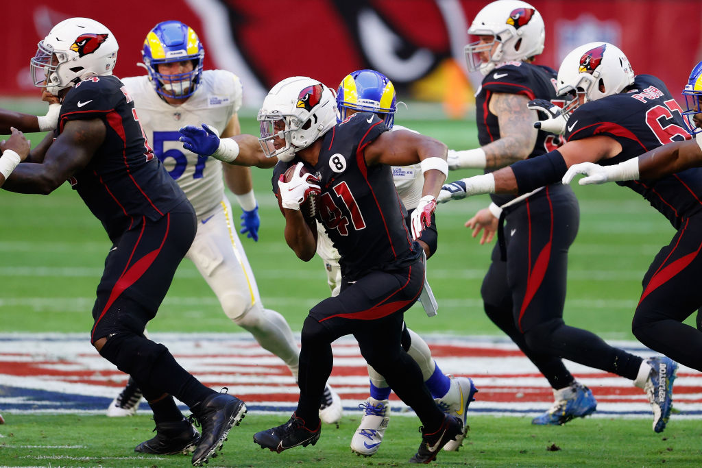 GLENDALE, ARIZONA - DECEMBER 06: Running back Kenyan Drake #41 of the Arizona Cardinals rushes the football against the Los Angeles Rams during the NFL game at State Farm Stadium on December 06, 2020 in Glendale, Arizona. The Rams defeated the Cardinals 38-28