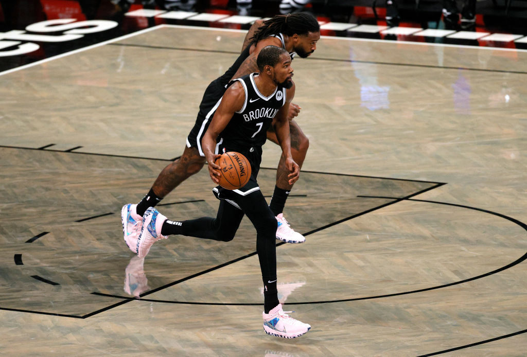 NEW YORK, NEW YORK - DECEMBER 13: Kevin Durant #7 of the Brooklyn Nets dribbles the ball during the second half against the Washington Wizards at Barclays Center on December 13, 2020 in the Brooklyn borough of New York City