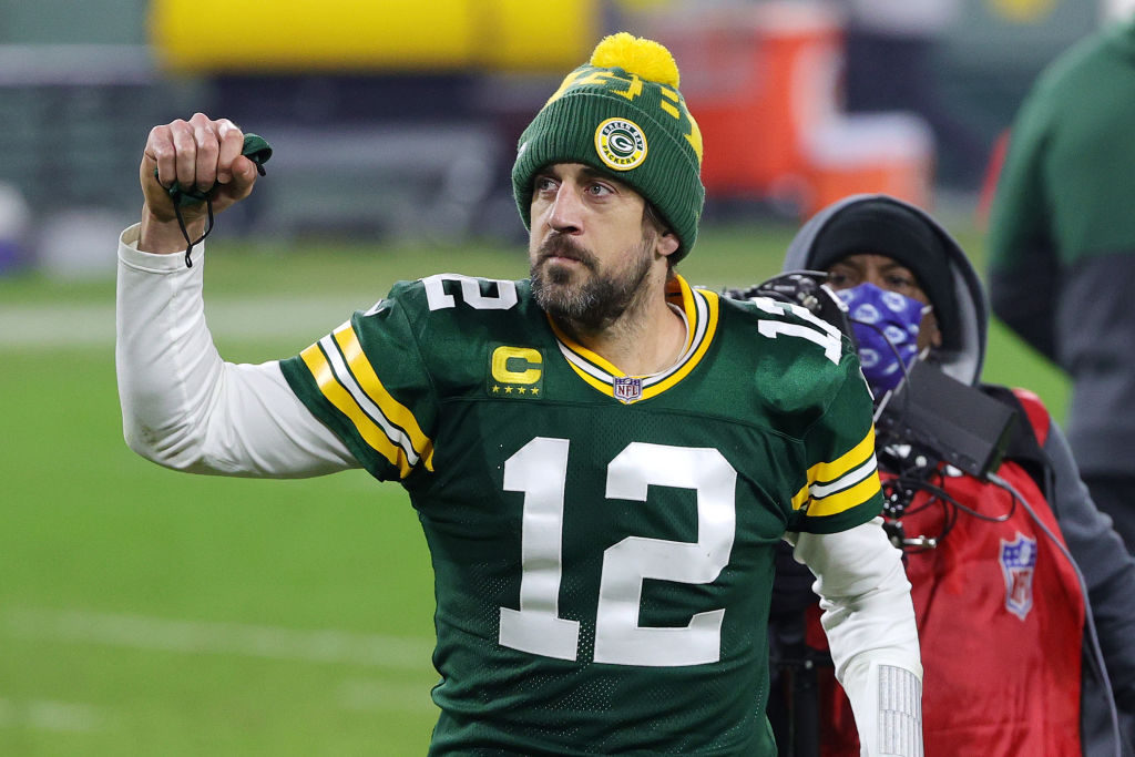 GREEN BAY, WISCONSIN - JANUARY 16: Aaron Rodgers #12 of the Green Bay Packers celebrates defeating the Los Angeles Rams 32-18 in the NFC Divisional Playoff game at Lambeau Field on January 16, 2021 in Green Bay, Wisconsin