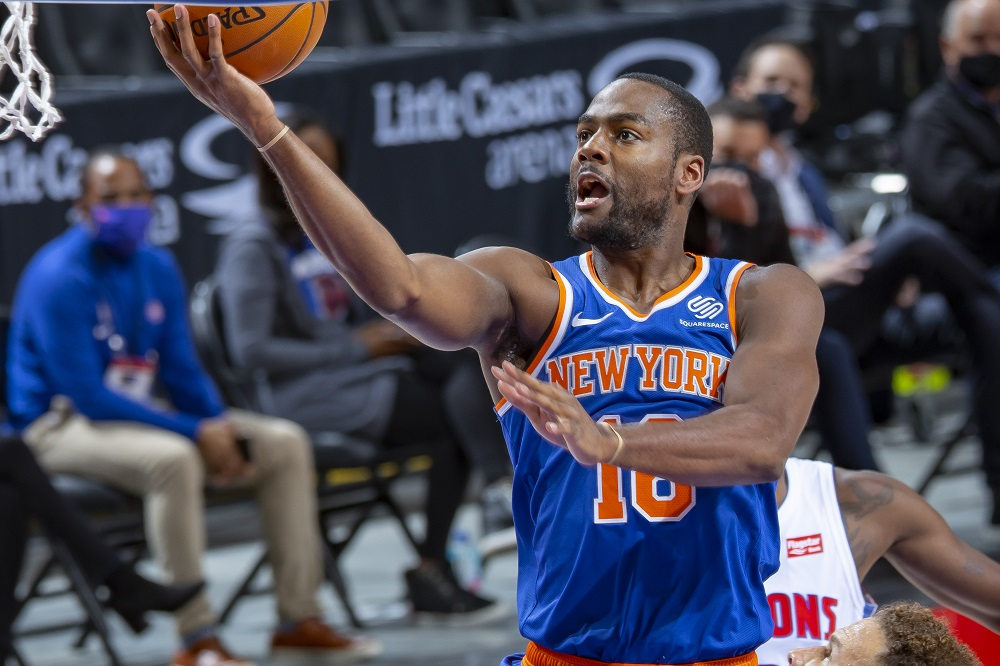 DETROIT, MI - DECEMBER 13: Alec Burks #18 of the New York Knicks drives to the basket in front of Blake Griffin #23 of the Detroit Pistons in the first half of an NBA game at Little Caesars Arena on December 13, 2020 in Detroit, Michigan