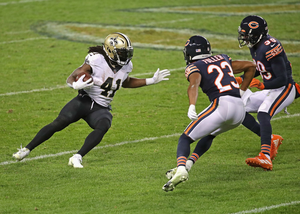 CHICAGO, ILLINOIS - NOVEMBER 01: Alvin Kamara #41 of the New Orleans Saints runs against Kyle Fuller #23 and Eddie Jackson #39 of the Chicago Bears at Soldier Field on November 01, 2020 in Chicago, Illinois. The Saints defeated the Bears 26-23 in overtime