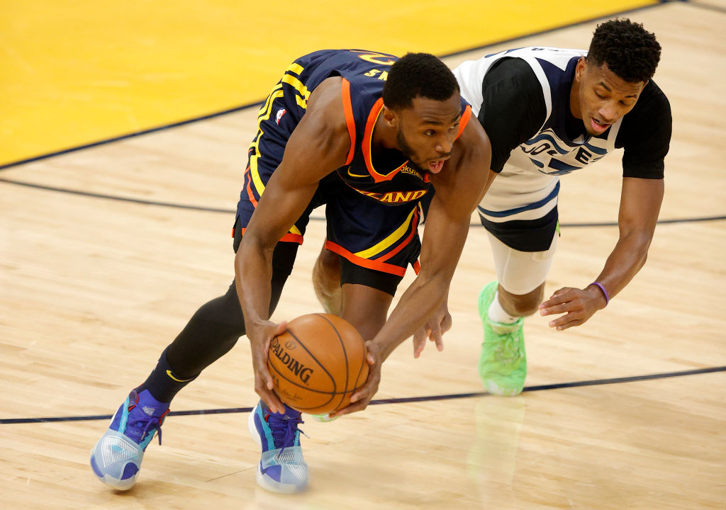 SAN FRANCISCO, CALIFORNIA - JANUARY 25: Andrew Wiggins #22 of the Golden State Warriors and Jarrett Culver #23 of the Minnesota Timberwolves go for a loose ball at Chase Center on January 25, 2021 in San Francisco, California