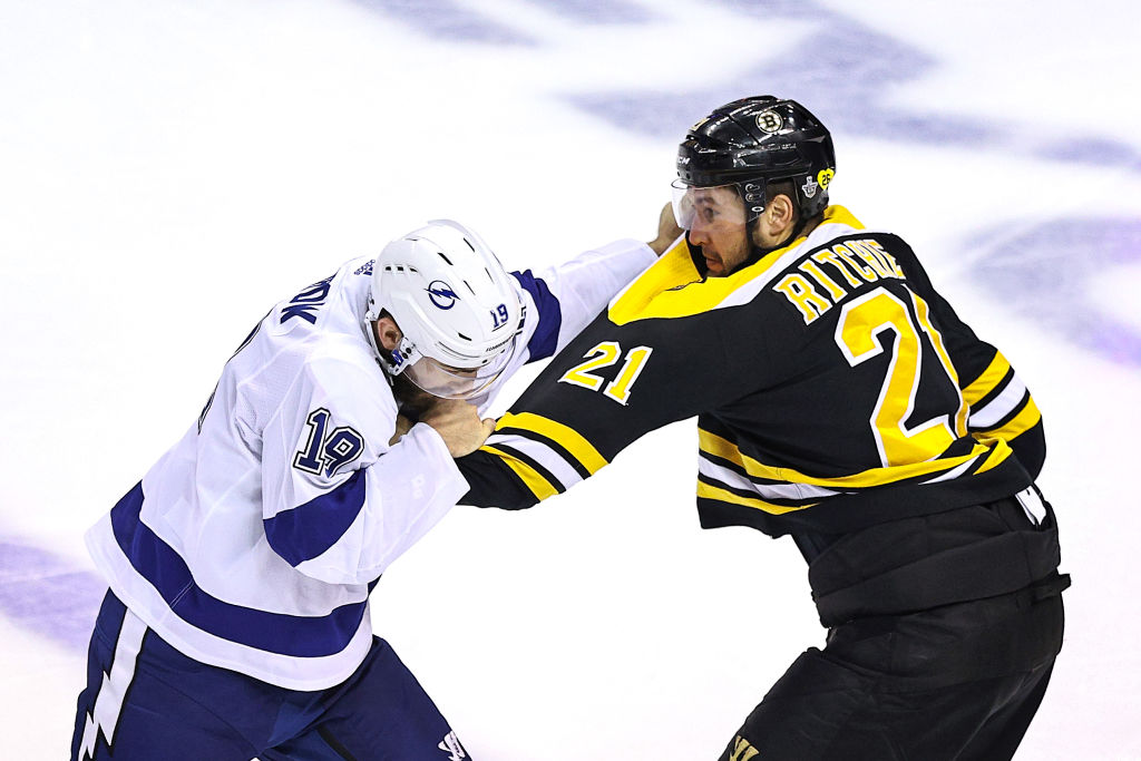 TORONTO, ONTARIO - AUGUST 29: Nick Ritchie #21 of the Boston Bruins fights Barclay Goodrow #19 of the Tampa Bay Lightning during the third period in Game Four of the Eastern Conference Second Round during the 2020 NHL Stanley Cup Playoffs at Scotiabank Arena on August 29, 2020 in Toronto, Ontario