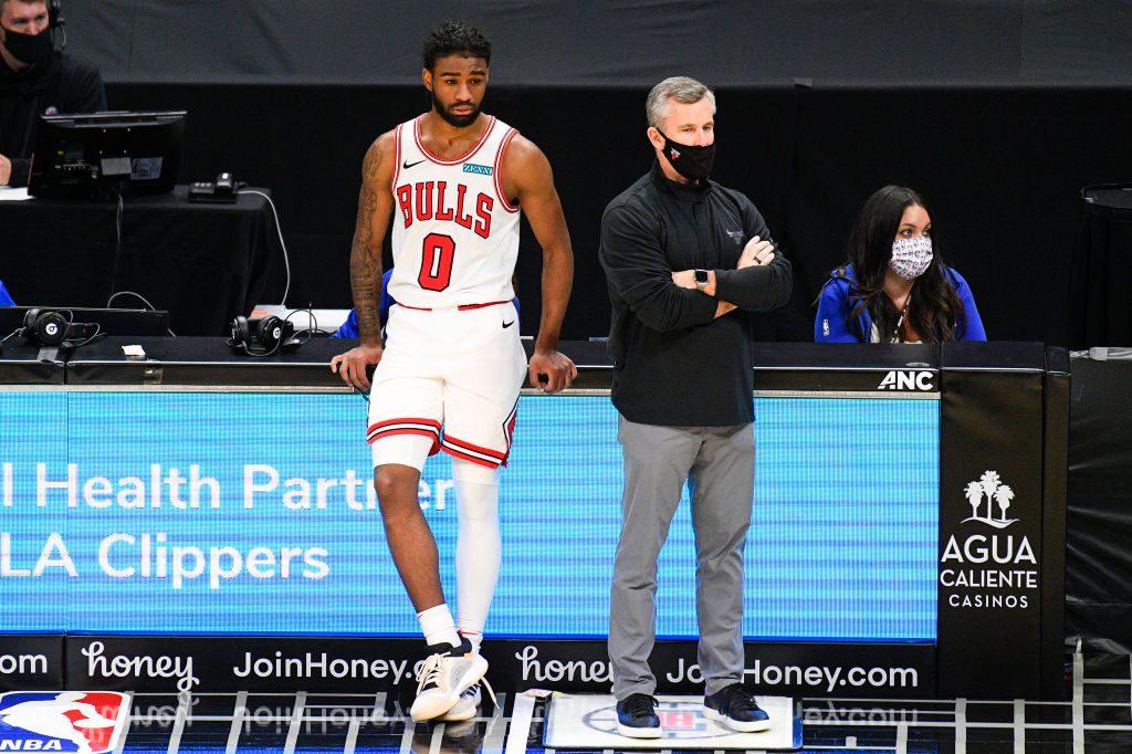LOS ANGELES, CA - JANUARY 10: Chicago Bulls Guard Coby White (0) and head coach Billy Donovan look on during a NBA game between the Chicago Bulls and the Los Angeles Clippers on January 10, 2021 at STAPLES Center in Los Angeles, CA.The game was played without fans due to the COVID-19 pandemic