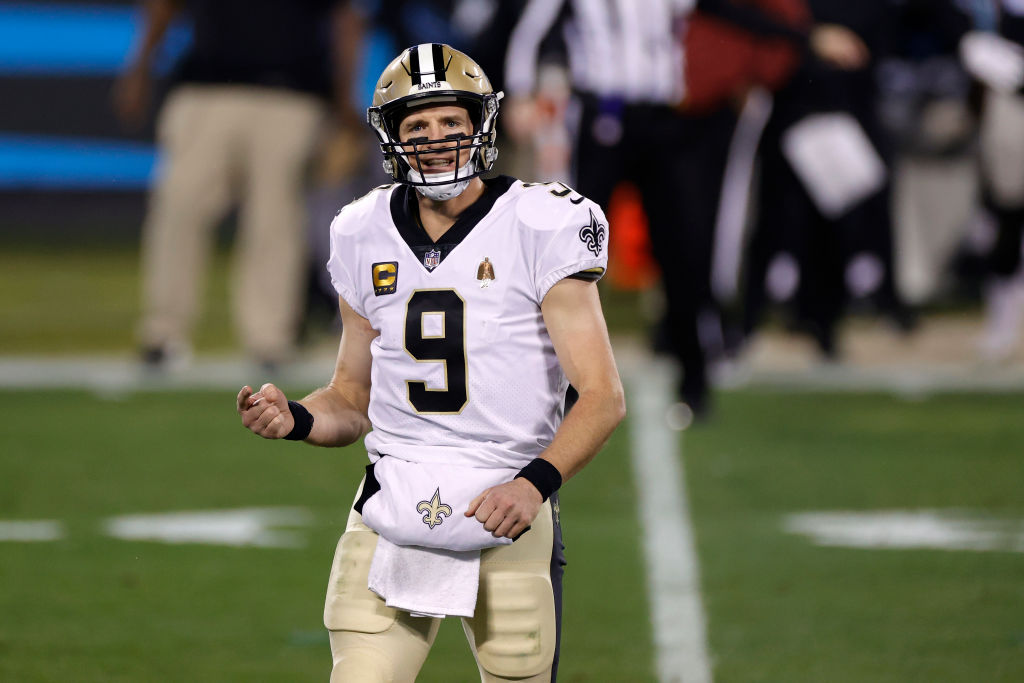 CHARLOTTE, NORTH CAROLINA - JANUARY 03: Quarterback Drew Brees #9 of the New Orleans Saints reacts following a play during the third quarter of their game against the Carolina Panthers at Bank of America Stadium on (Photo by