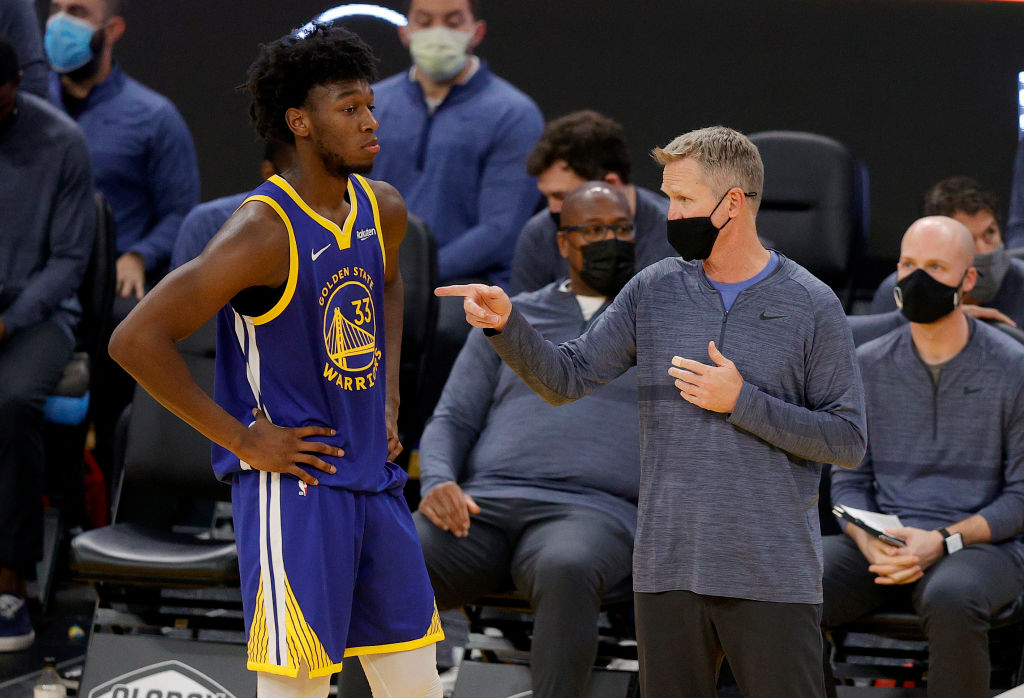 SAN FRANCISCO, CALIFORNIA - JANUARY 12: Head coach Steve Kerr speaks to James Wiseman #33 of the Golden State Warriors after he picked up his fourth foul in their game against the Indiana Pacers in the second period at Chase Center on January 12, 2021 in San Francisco, California