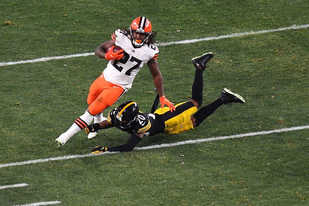 PITTSBURGH, PENNSYLVANIA - JANUARY 10: Kareem Hunt #27 of the Cleveland Browns avoids a tackle by Cameron Sutton #20 of the Pittsburgh Steelers during the second half of the AFC Wild Card Playoff game at Heinz Field on January 10, 2021 in Pittsburgh, Pennsylvania