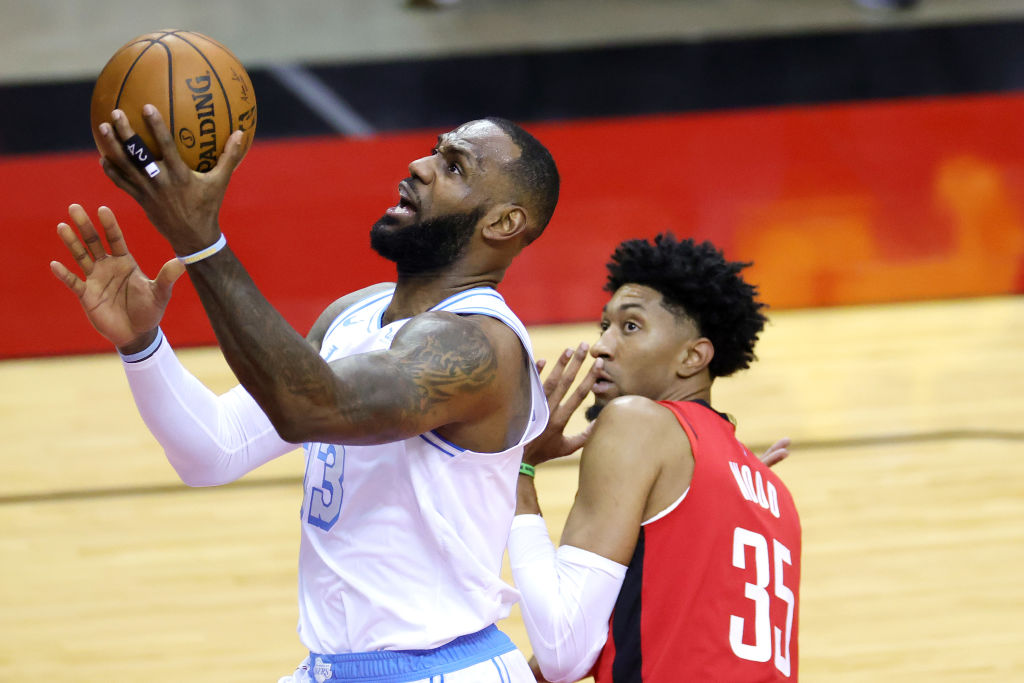 HOUSTON, TEXAS - JANUARY 10: LeBron James #23 of the Los Angeles Lakers goes up for a basket ahead of Christian Wood #35 of the Houston Rockets during the first quarter of a game at Toyota Center on January 10, 2021 in Houston, Texas