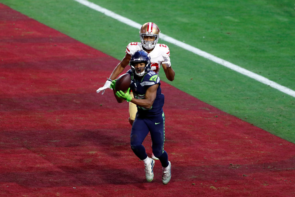 GLENDALE, ARIZONA - JANUARY 03: Wide receiver Tyler Lockett #16 of the Seattle Seahawks catches the game winning touchdown over cornerback Ahkello Witherspoon #23 of the San Francisco 49ers during the fourth quarter at State Farm Stadium on January 03, 2021 in Glendale, Arizona