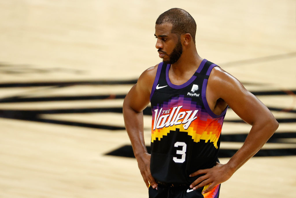 PHOENIX, ARIZONA - JANUARY 23: Chris Paul #3 of the Phoenix Suns reacts during overtime of the NBA game against the Denver Nuggets at Phoenix Suns Arena on January 23, 2021 in Phoenix, Arizona. The Nuggets defeated the Suns 120-112