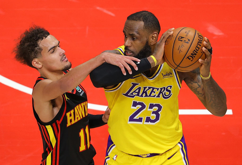 ATLANTA, GEORGIA - FEBRUARY 01: Trae Young #11 of the Atlanta Hawks fouls LeBron James #23 of the Los Angeles Lakers in the finals seconds of the second half at State Farm Arena on February 01, 2021 in Atlanta, Georgia