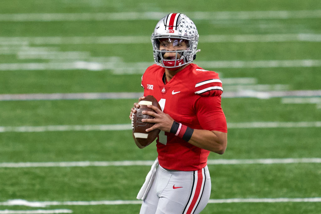 INDIANAPOLIS, IN - DECEMBER 19: Ohio State Buckeyes quarterback Justin Fields (1) throws the football in action during the Big Ten Championship game between the Ohio State Buckeyes and the Northwestern Wildcats on December 19, 2020 at Lucas Oil stadium, in Indianapolis, IN