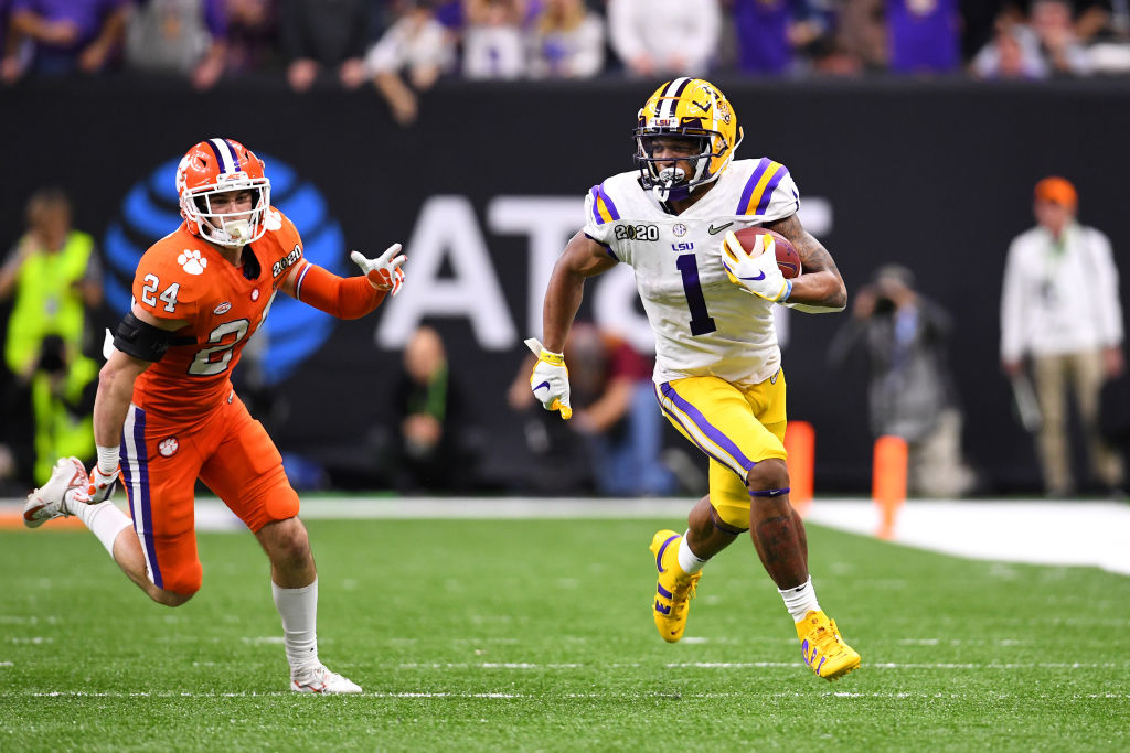 NEW ORLEANS, LA - JANUARY 13: Ja'Marr Chase #1 of the LSU Tigers races past Nolan Turner #24 of the Clemson Tigers during the College Football Playoff National Championship held at the Mercedes-Benz Superdome on January 13, 2020 in New Orleans, Louisiana