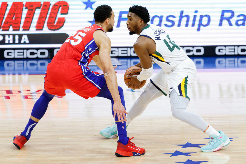 PHILADELPHIA, PENNSYLVANIA - MARCH 03: Donovan Mitchell #45 of the Utah Jazz is guarded by Ben Simmons #25 of the Philadelphia 76ers during the first quarter at Wells Fargo Center on March 03, 2021 in Philadelphia, Pennsylvania
