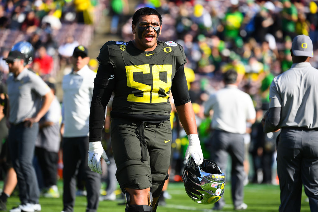 PASADENA, CA - JANUARY 01: Oregon Ducks (58) Penei Sewell (OL) looks on before the Rose Bowl game between the Wisconsin Badgers and the Oregon Ducks on January 1, 2020 at the Rose Bowl in Pasadena, CA.