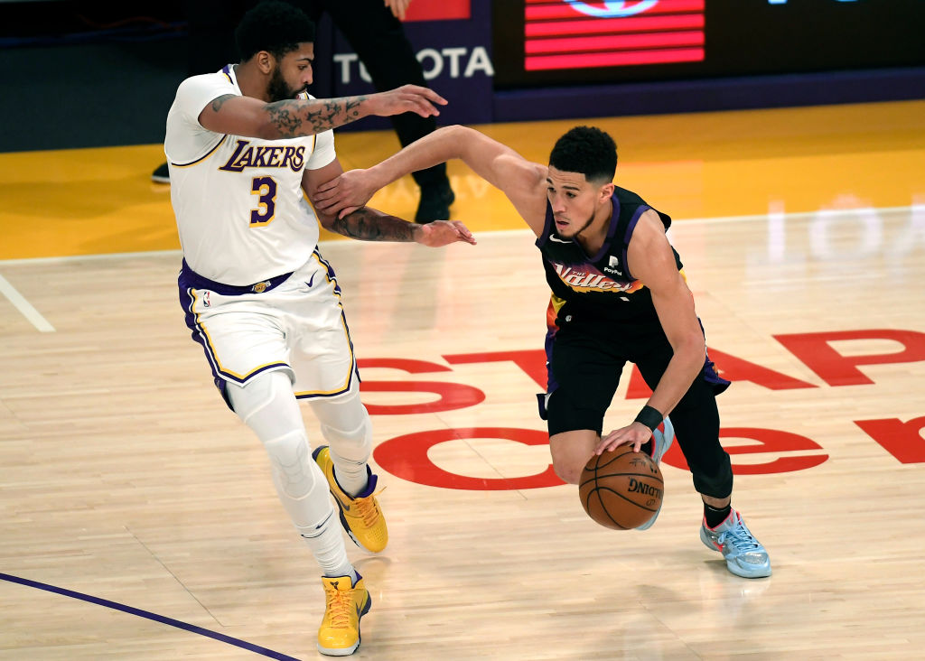 LOS ANGELES, CA - MAY 09: Devin Booker #1 of the Phoenix Suns is defended by Anthony Davis #3 of the Los Angeles Lakers during the first half at Staples Center on May 9, 2021 in Los Angeles, California