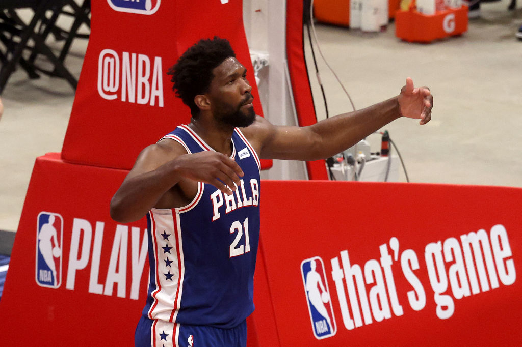 WASHINGTON, DC - MAY 29: Joel Embiid #21 of the Philadelphia 76ers reacts after scoring against the Washington Wizards in the first half during Game Three of the Eastern Conference first round series at Capital One Arena on May 29, 2021 in Washington, DC.