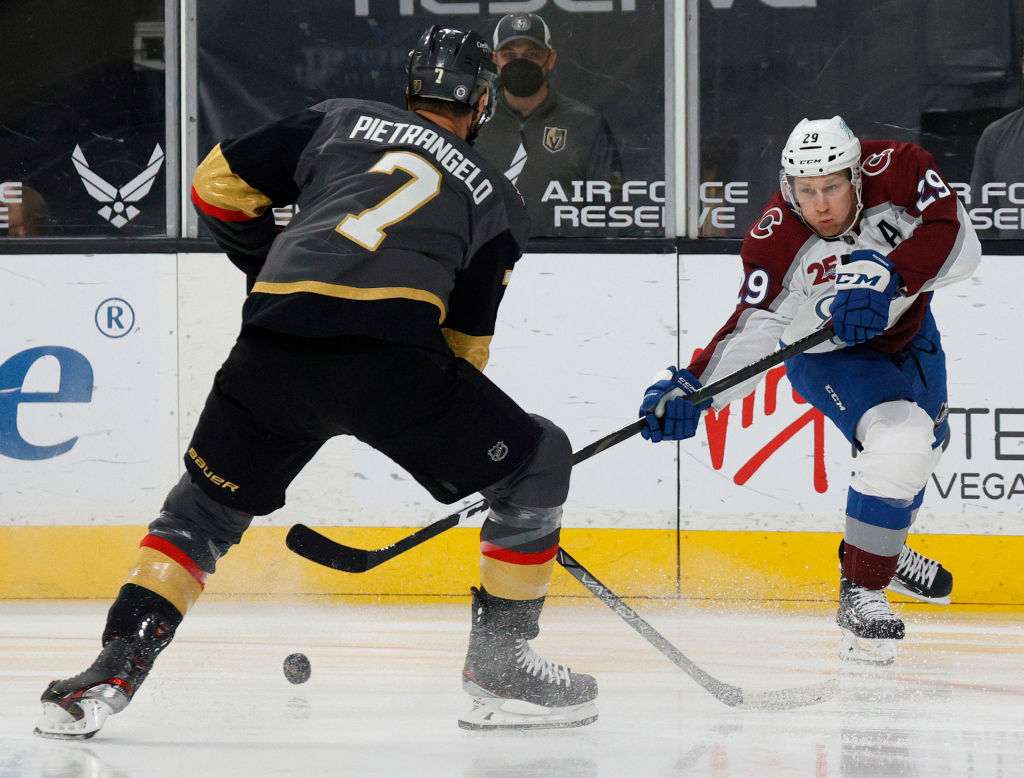 LAS VEGAS, NEVADA - MAY 10: Nathan MacKinnon #29 of the Colorado Avalanche passes against Alex Pietrangelo #7 of the Vegas Golden Knights in the first period of their game at T-Mobile Arena on May 10, 2021 in Las Vegas, Nevada. The Avalanche defeated the Golden Knights 2-1