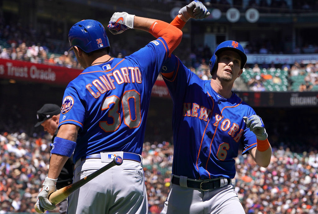 SAN FRANCISCO, CA - JULY 20: Jeff McNeil #6 of the New York Mets is congratulated by Michael Conforto #30 after McNeil hit a two-run home run against the San Francisco Giants in the top of the fifth inning at Oracle Park on July 20, 2019 in San Francisco, California