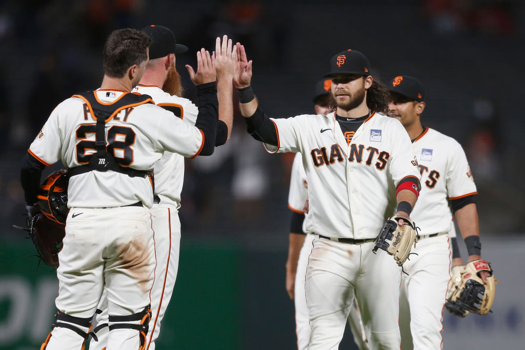 SAN FRANCISCO, CALIFORNIA - JUNE 03: Brandon Crawford #35 of the San Francisco Giants celebrates with teammates after a win against the Chicago Cubs at Oracle Park on June 03, 2021 in San Francisco, California