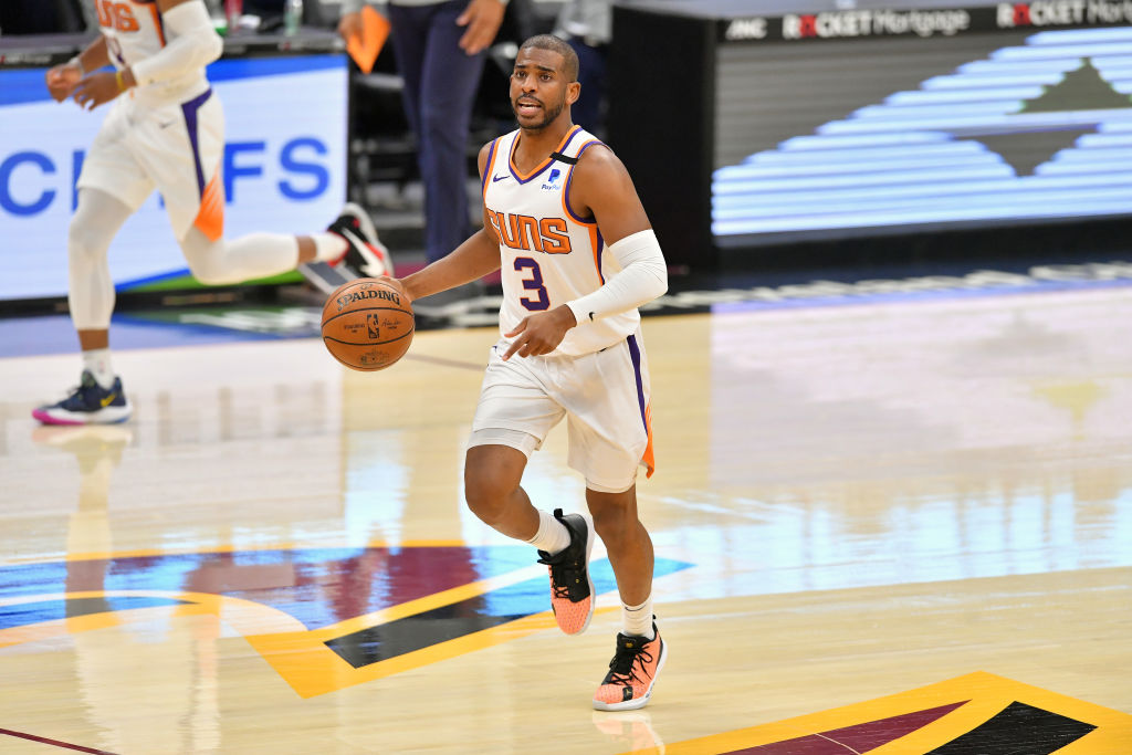 CLEVELAND, OHIO - MAY 04: Chris Paul #3 of the Phoenix Suns brings the ball up court during the second quarter against the Cleveland Cavaliers at Rocket Mortgage Fieldhouse on May 04, 2021 in Cleveland, Ohio