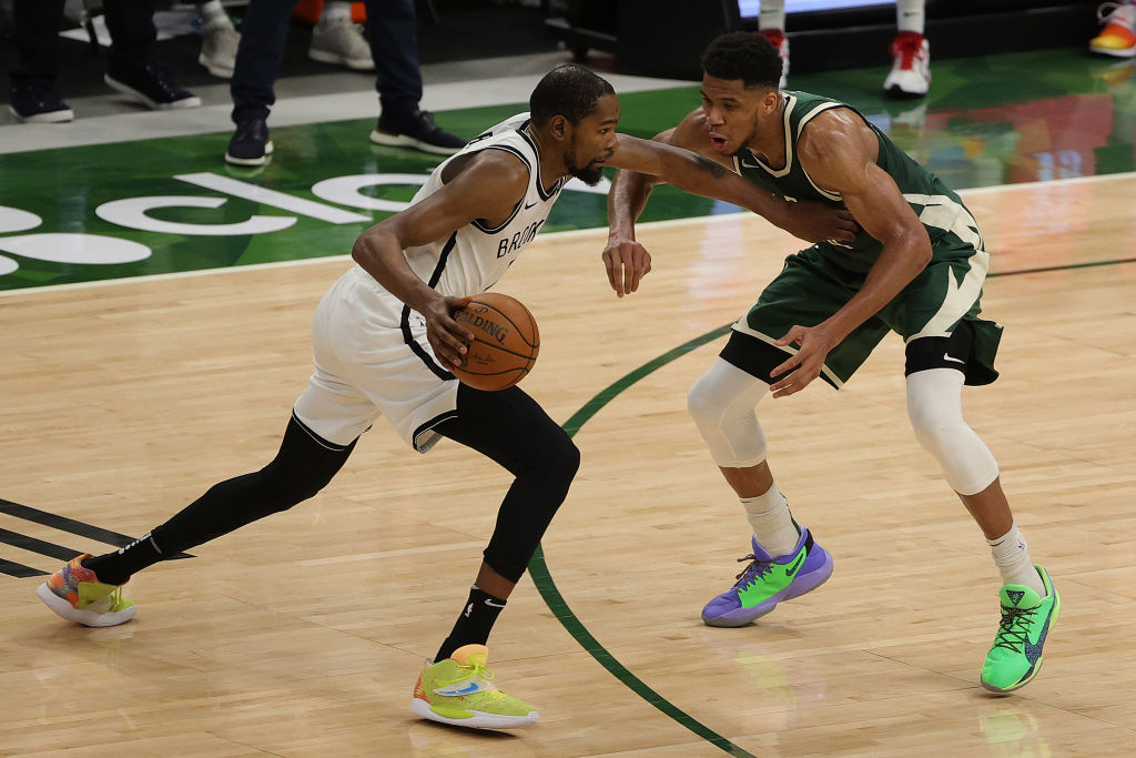 MILWAUKEE, WISCONSIN - MAY 02: Kevin Durant #7 of the Brooklyn Nets is defended by Giannis Antetokounmpo #34 of the Milwaukee Bucks during a game at Fiserv Forum on May 02, 2021 in Milwaukee, Wisconsin