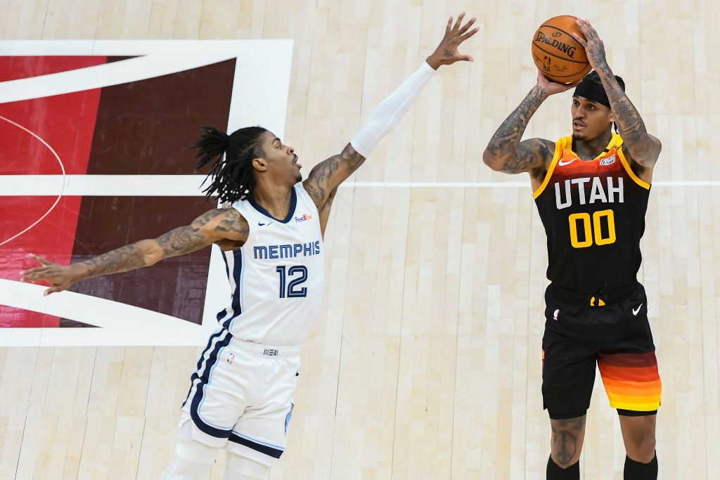 SALT LAKE CITY, UTAH - JUNE 02: Jordan Clarkson #00 of the Utah Jazz shoots over Ja Morant #12 of the Memphis Grizzlies in Game Five of the Western Conference first-round playoff series at Vivint Smart Home Arena on June 2, 2021 in Salt Lake City, Utah