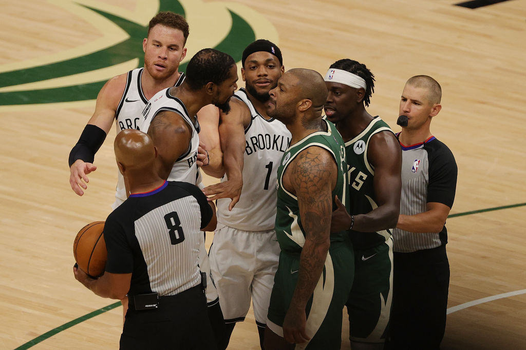 MILWAUKEE, WISCONSIN - JUNE 10: Kevin Durant #7 of the Brooklyn Nets and P.J. Tucker #17 of the Milwaukee Bucks exchange words during the second half of Game Three of the Eastern Conference second round playoff series at the Fiserv Forum on June 10, 2021 in Milwaukee, Wisconsin