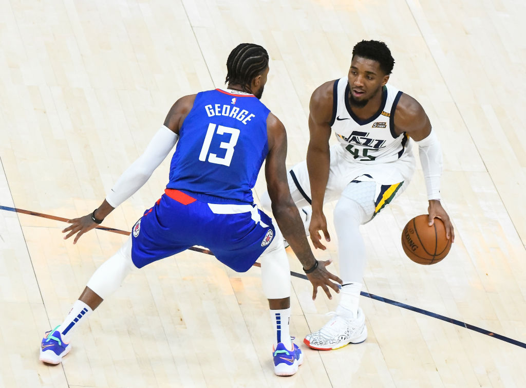 SALT LAKE CITY, UT - JANUARY 01: Donovan Mitchell #45 of the Utah Jazz looks to drive around Paul George #13 of the LA Clippers during a game at Vivint Smart Home Arena on January 1, 2021 in Salt Lake City, Utah.