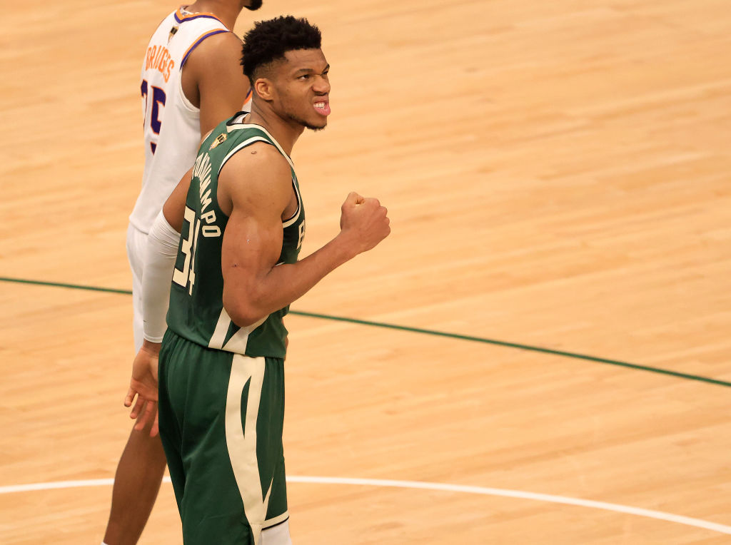 MILWAUKEE, WISCONSIN - JULY 11: Giannis Antetokounmpo #34 of the Milwaukee Bucks celebrates during the second half in Game Three of the NBA Finals against the Phoenix Suns at Fiserv Forum on July 11, 2021 in Milwaukee, Wisconsin