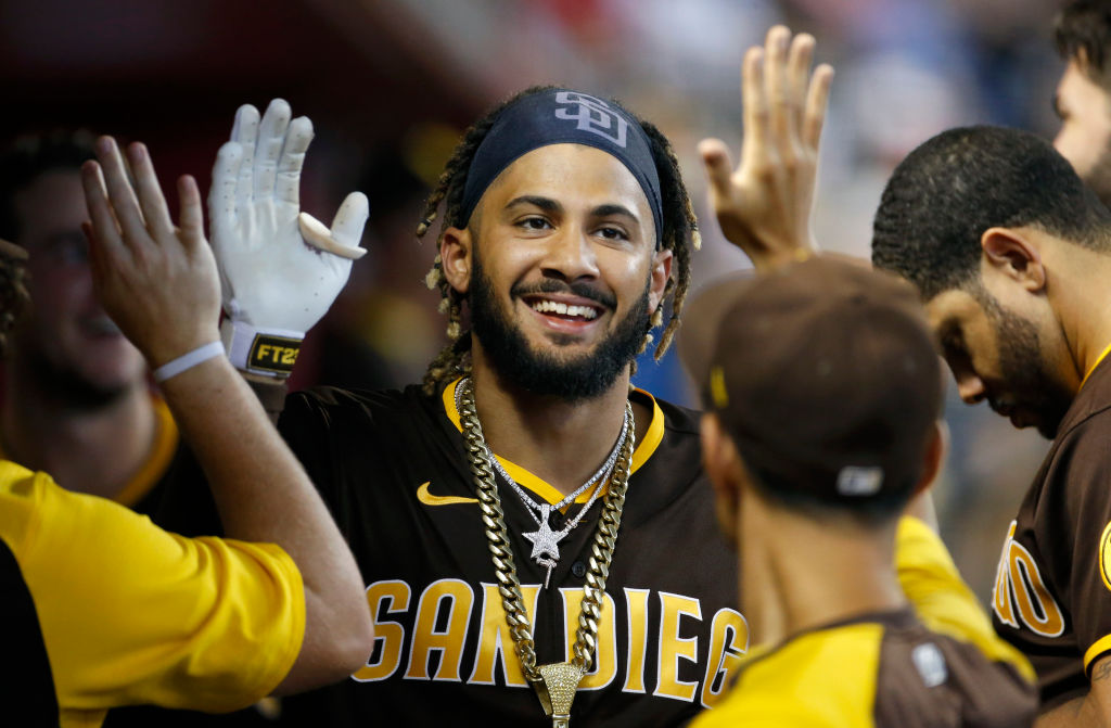 PHOENIX, ARIZONA - AUGUST 15: Fernando Tatis Jr #23 of the San Diego Padres is congratulated by teammates after hitting a solo home run against the Arizona Diamondbacks during the fifth inning of the MLB game at Chase Field on August 15, 2021 in Phoenix, Arizona. It was Tatis' second homer of the game