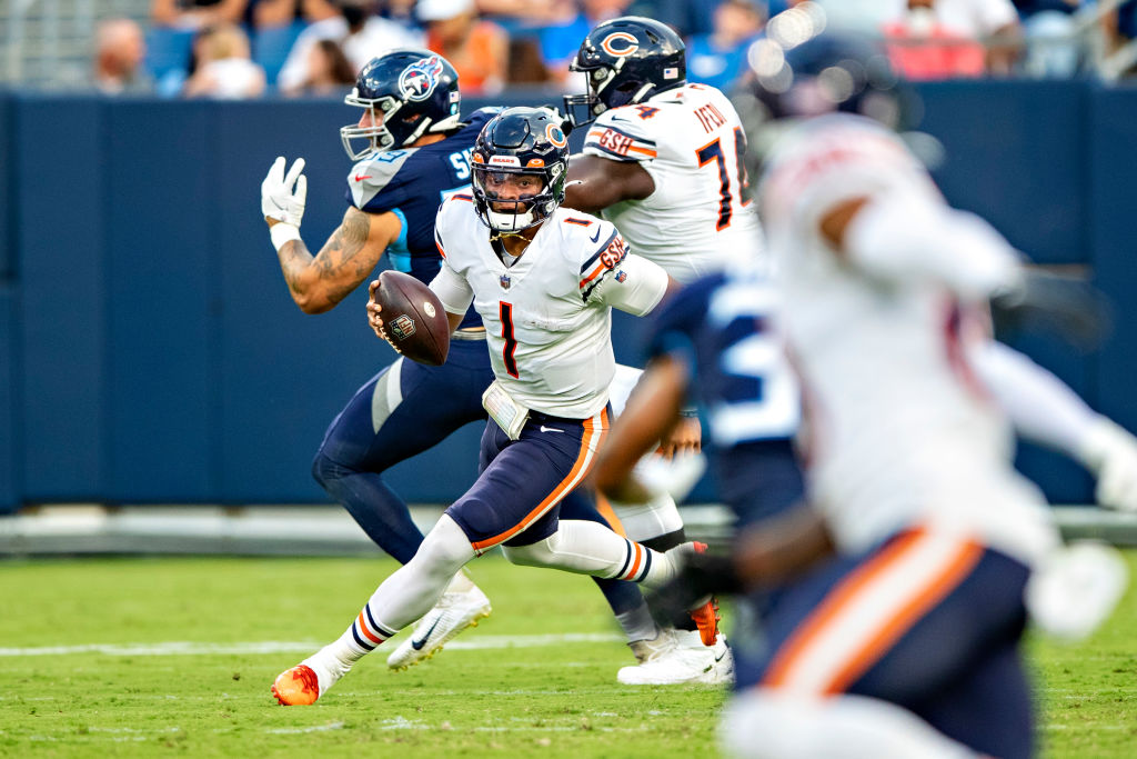 NASHVILLE, TN - AUGUST 28: Justin Fields #1 of the Chicago Bears runs the ball up the middle during an NFL preseason game against the Tennessee Titans at Nissan Stadium on August 28, 2021 in Nashville, Tennessee