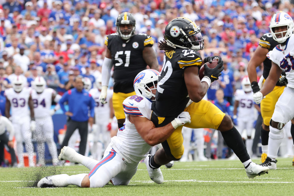 ORCHARD PARK, NEW YORK - SEPTEMBER 12: Matt Milano #58 of the Buffalo Bills tackles Najee Harris #22 of the Pittsburgh Steelers during the third quarter at Highmark Stadium on September 12, 2021 in Orchard Park, New York