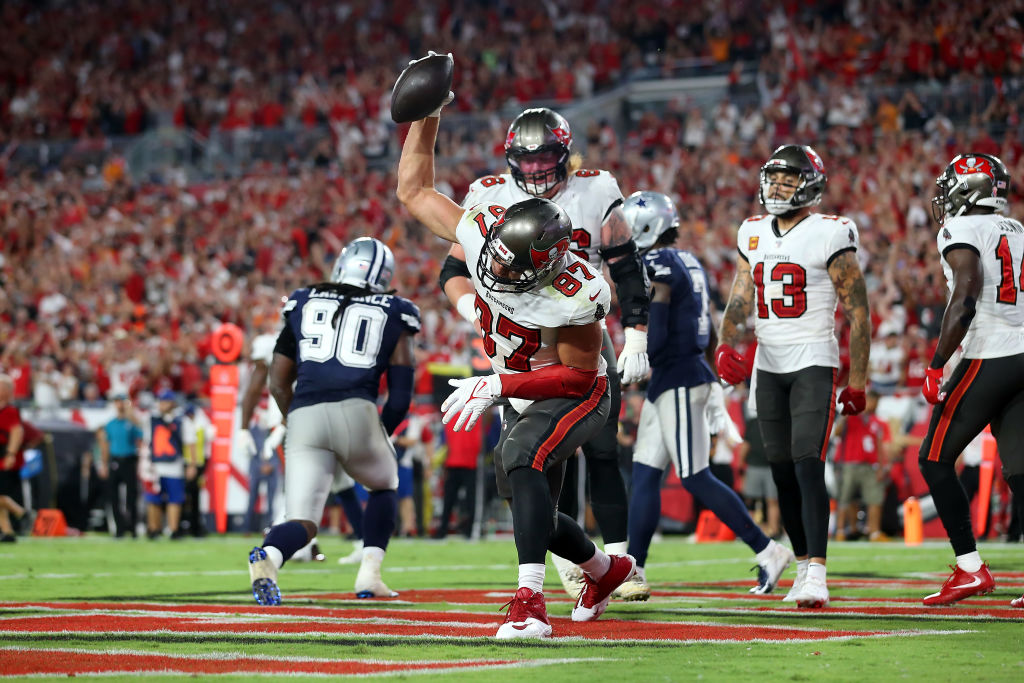 TAMPA, FL - SEPTEMBER 09: Rob Gronkowski (87) of the Buccaneers scores a touchdown and then spikes the ball in the end zone during the regular season game between the Dallas Cowboys and the Tampa Bay Buccaneers on September 09, 2021 at Raymond James Stadium in Tampa, Florida