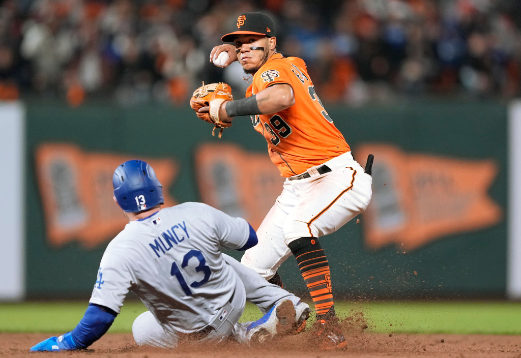 SAN FRANCISCO, CALIFORNIA - SEPTEMBER 03: Thairo Estrada #39 of the San Francisco Giants completes the double-play throwing over the top of Max Muncy #13 of the Los Angeles Dodgers in the top of the six inning at Oracle Park on September 03, 2021 in San Francisco, California